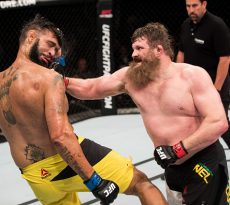 BRASILIA, BRAZIL - SEPTEMBER 24: Roy Nelson of the United States punches Antonio Silva of Brazil in their heavyweight UFC bout during the UFC Fight Night event at Nilson Nelson gymnasium on September 24, 2016 in Brasilia, Brazil. (Photo by Buda Mendes/Zuffa LLC/Zuffa LLC via Getty Images)
