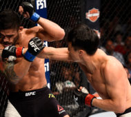 LAS VEGAS, NV - JULY 08:  (R-L) Doo Ho Choi of South Korea knocks down Thiago Tavares of Brazil with a punch in their featherweight bout during The Ultimate Fighter Finale event at MGM Grand Garden Arena on July 8, 2016 in Las Vegas, Nevada.  (Photo by Jeff Bottari/Zuffa LLC/Zuffa LLC via Getty Images)