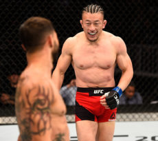 SALT LAKE CITY, UT - AUGUST 06:  (R-L) Tatsuya Kawajiri of Japan circles Cub Swanson in their featherweight bout during the UFC Fight Night event at Vivint Smart Home Arena on August 6, 2016 in Salt Lake City, Utah. (Photo by Jeff Bottari/Zuffa LLC/Zuffa LLC via Getty Images)