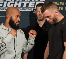 LAS VEGAS, NV - DECEMBER 01:  (L-R) UFC flyweight champion Demetrious Johnson and TUF 24 winner Tim Elliott face off during the TUF Finale Ultimate Media Day in the Palms Resort & Casino on December 1, 2016 in Las Vegas, Nevada. (Photo by Brandon Magnus/Zuffa LLC/Zuffa LLC via Getty Images)
